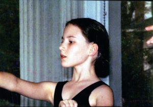 Rachel, training hard in ballet class. Around age 10.